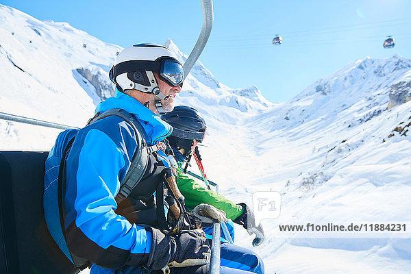 Father and son on ski lift  Hintertux  Tirol  Austria