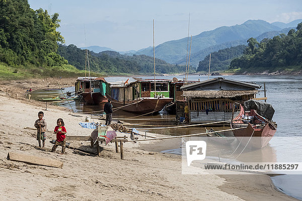 'Boats and floating houses tied to the shore; Sainyabuli Province  Laos'