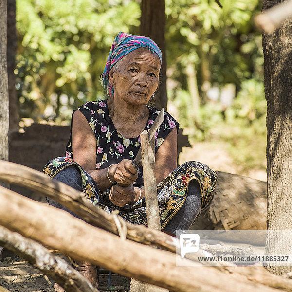'Portrait of a mature woman sitting in Kamu village; Tambon Po  Chang Wat Chiang Rai  Thailand'