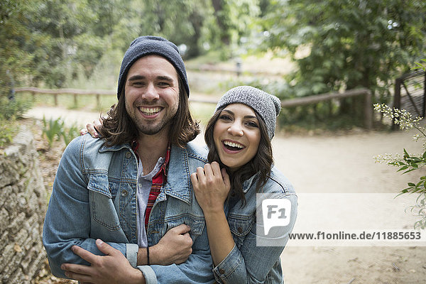 Portrait of cheerful couple at park