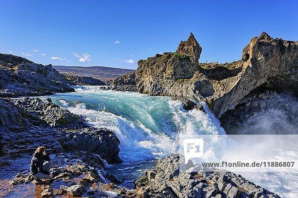 Female tourist at waterfall Godafoss  Laugar  Fosshólli  Iceland  Europe