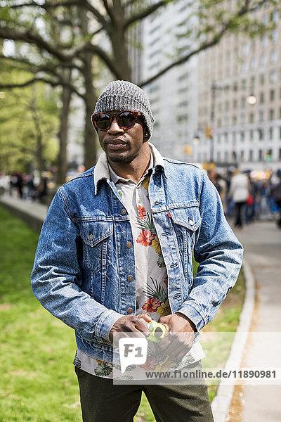 USA  New York City  Manhattan  portrait of stylish man wearing wooly hat and sunglasses