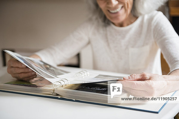 Older woman enjoying a photo album