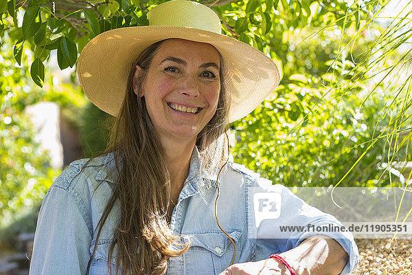 Portrait of smiling older Caucasian woman in garden
