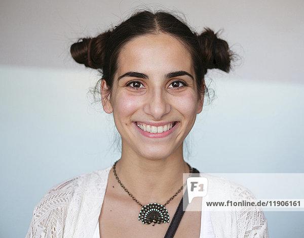 Portrait of smiling Caucasian woman wearing necklace