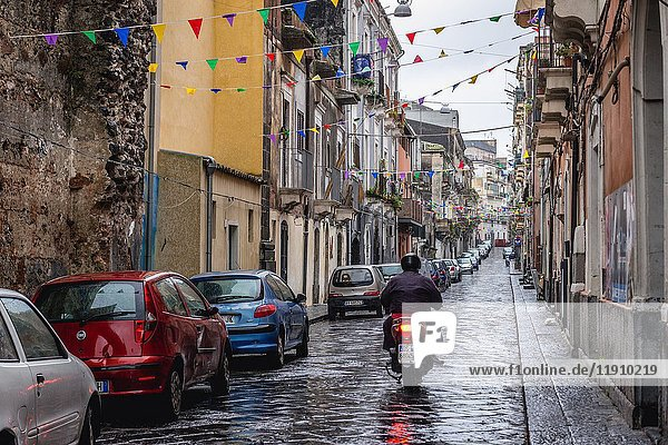 Narrow street in Catania city on the east side of Sicily Island  Italy.