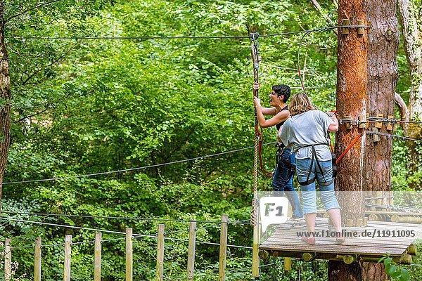 Women in Adventure Park  Saint-Benoît-la-Forêt  Chinon District  Indre-et-Loire Department  Centre-Val de Loire Region  Loire valley  France  Europe.