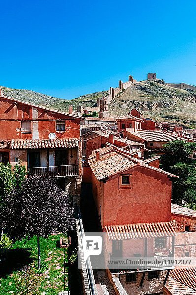 Houses and stone wall in the medieval village of Albarracin  Teruel  Spain.