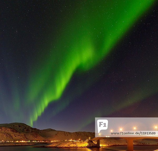 Northern Lights over the bridges of Fredvang (Fredvangbruene) connecting the islands Moskenesoya and Flakstadoya. The Lofoten Islands in northern Norway during winter. Europe  Scandinavia  Norway  February.