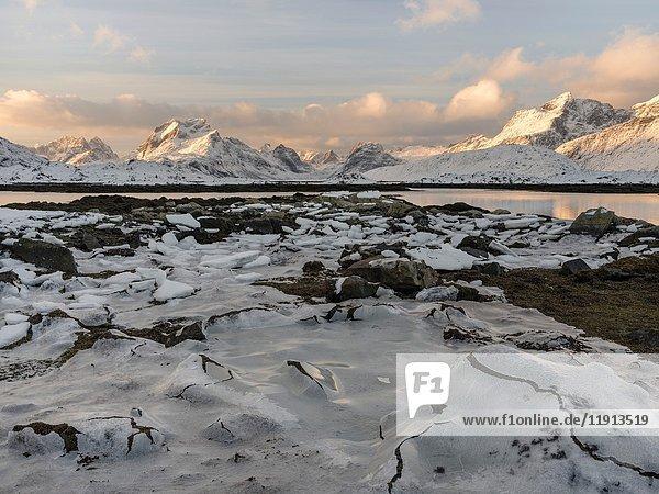 Mountains of Moskenesoya rising over Selfjorden and Torsfjorden near village Fredvang  seen from Flakstadoya. The Lofoten Islands in northern Norway during winter. Europe  Scandinavia  Norway  February.