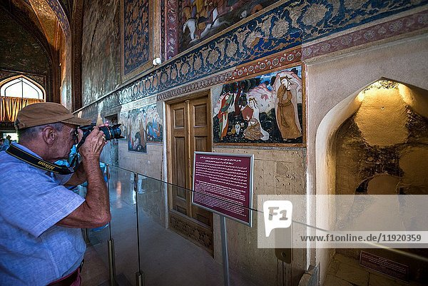 Tourist in main hall of Palace of Forty Columns (Chehel Sotoun) in Isfahan  capital of Isfahan Province in Iran.