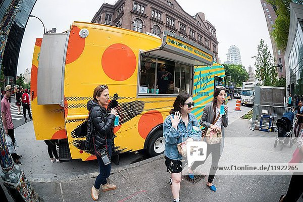 Hundreds of burger lovers line up for free Amy's Drive Thru vegetarian burgers and fries at a branding event in Astor Place in New York