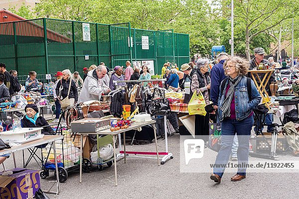 Shoppers search for bargains at the humongous Penn South Flea Market in the New York neighborhood of Chelsea