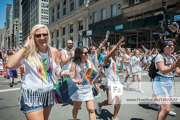 PVH employees march in the the annual Lesbian,  Gay,  Bisexual,  Transgender and Queer (LGBTQ) Pride Parade on Fifth Avenue in New York on Sunday,  June 25,  2017. Besides the corporate sponsors,  politicians and various social service groups many participants carried political themed signs showing their dissatisfaction with President Trump.