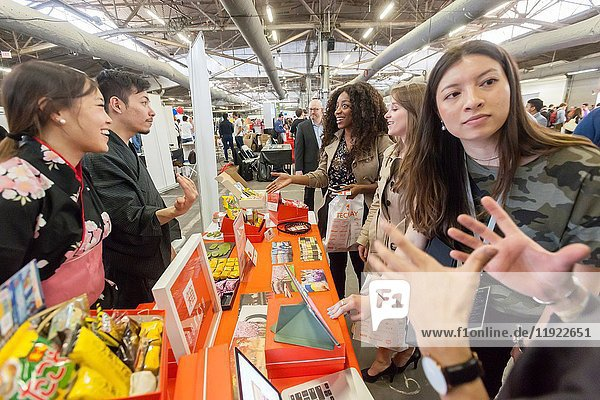 Workers from Bokksu  a Japanese snack subscription start-up  speak to attendees at the TechDay New York event on Tuesday  April 18  2017. Thousands attended to seek jobs with the startups and to network with their peers. TechDay bills itself as the U. S. 's largest startup event with over 500 exhibitors.