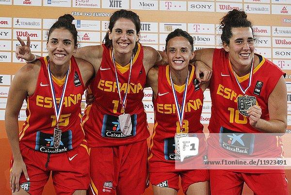 Spainâ.s Womenâ.s 3X3 Basketball players L/R Irene San Roman  Cristina Hurtado  Paula Palomares and Aitana Cuevas Mediavill celebrates on the podium with Siver medal for FIBA 3X3 Europe Cup 2017 at Museumplein on July 9  2017 in Amsterdam Netherlands.