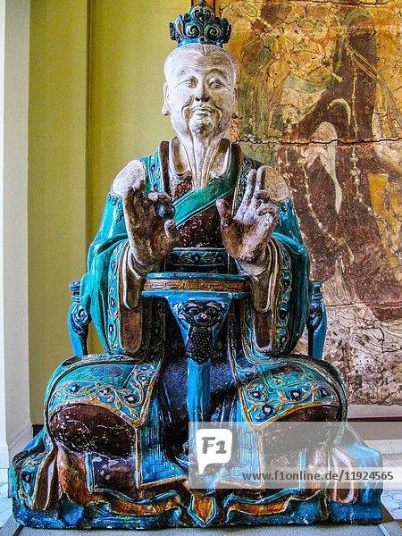 Chinese stoneware ceramic figure of Buddhism  Interior of the British Museum  London  England.