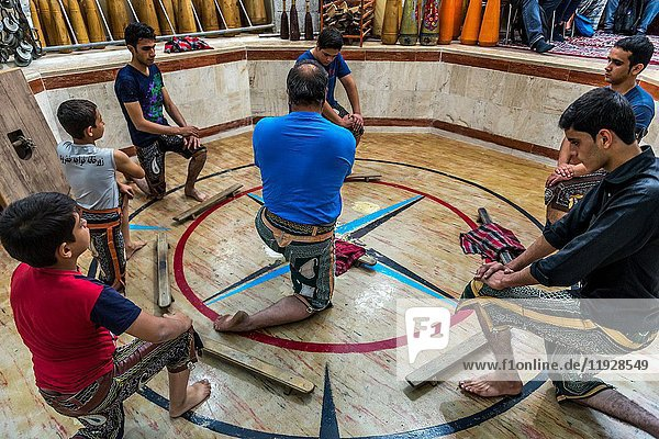 Warm up during training session in Zoorkhaneh (House of Strength)  traditional gymnasium in Yazd city  capital of Yazd Province of Iran.