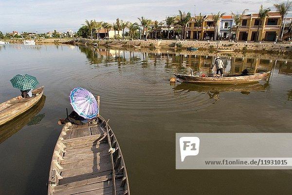 Fishing boats on the Song Thu Bon river  Hoi An  Vietnam  Southeast Asia.