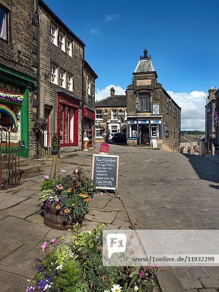 Shops and Tourist Information Centre on Main Street at Haworth West Yorkshire England.