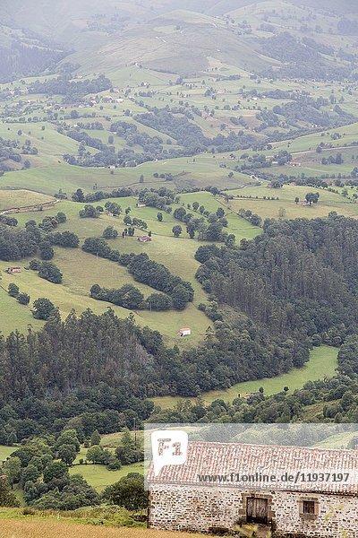 Valles Pasiegos Cantabria landscape wiht green field Spain.