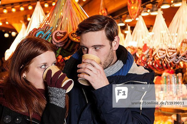 Couple drinking wine on christmas market.