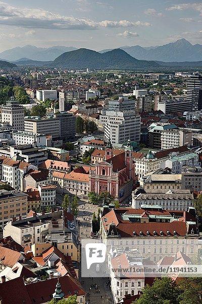 Ljubljana capital city of Slovenia with the Karawanks  Kamnik Savinja limestone Alps and Franciscan Church at Preseren Square from Ljubljana Castle.