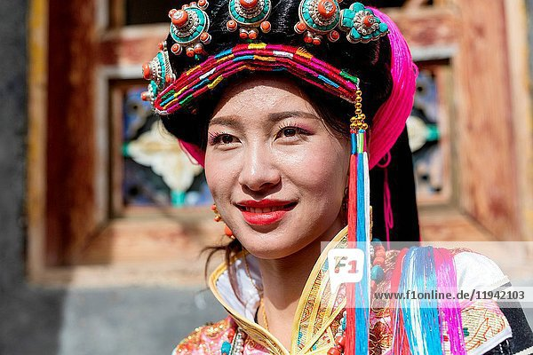 A girl dressed in national costume in Badan County Sichuan province China