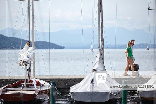 Germany  Bavaria  Lake Starnberg  couple at marina
