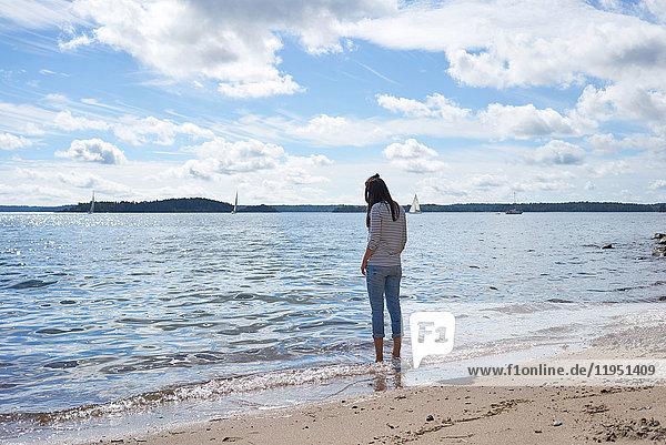 Sweden  Grinda island  woman on the beach