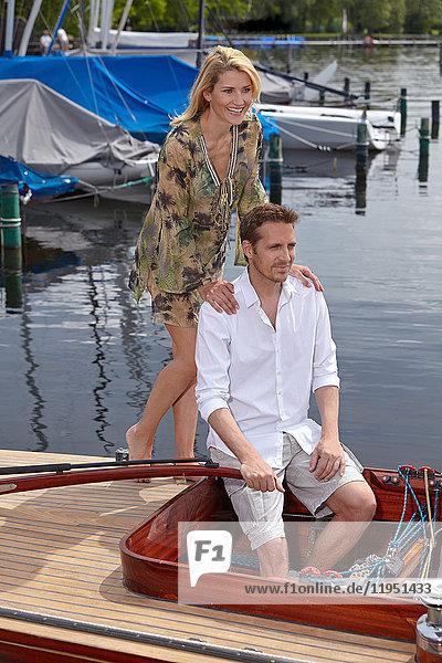 Germany  Bavaria  Lake Starnberg  couple in sailboat