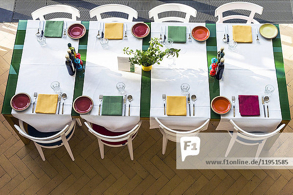 Laid table with colorful table setting