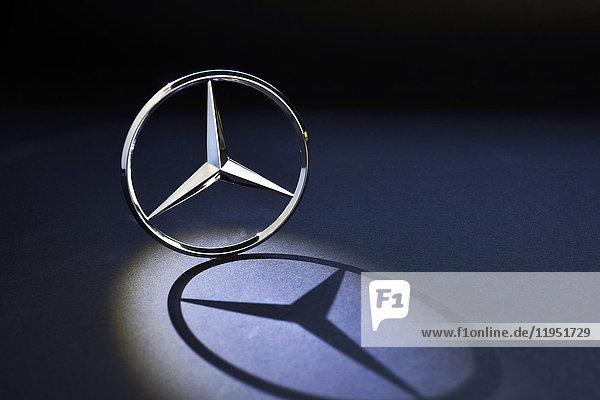 Mercedes logo casting a shadow