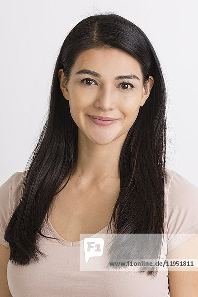 Portrait of smiling dark-haired woman