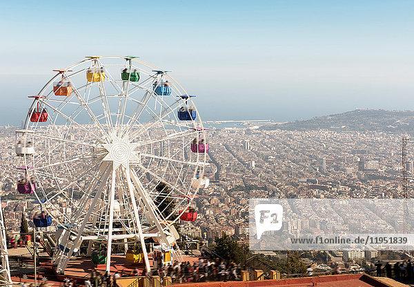 View from the Tibidabo amusement park with the Giradabo big wheel  Barcelona  Catalonia  Spain