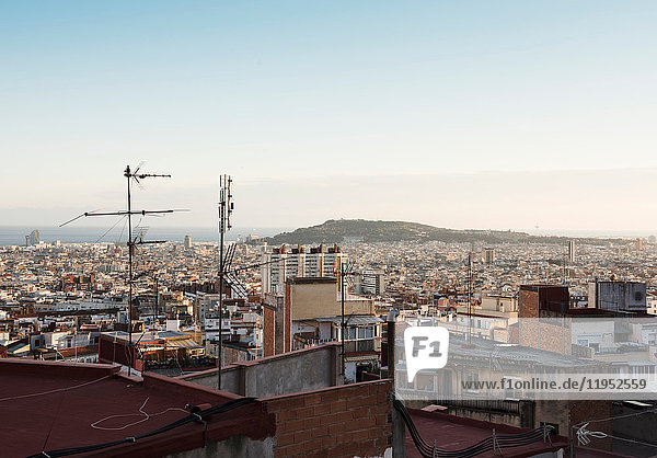 Cityscape view with rooftop aerials  Barcelona  Spain