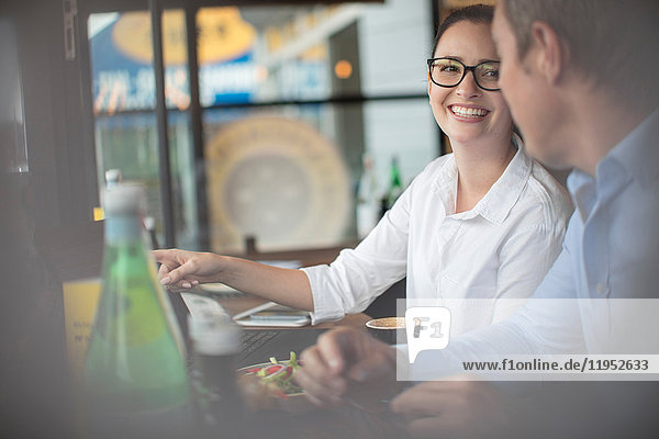 Couple in coffee shop smiling