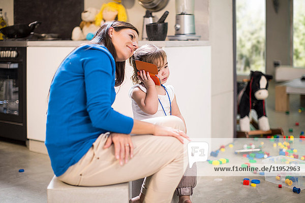 Mother listening in on baby girl's telephone call