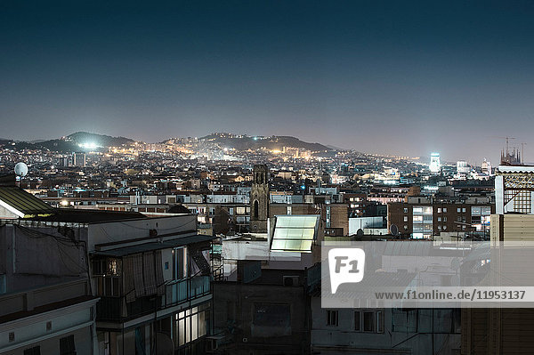 Cityscape and city lights at night  Barcelona  Spain