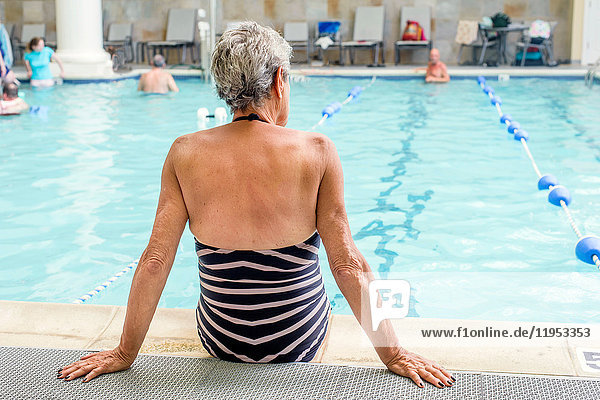Senior woman by poolside