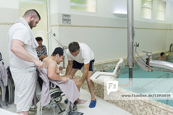 Reportage at the thermal baths in Lamalou-les-Bains  France. Leroy Pavilion  care service devoted to neurological disorders. The hydrotherapist uses the hydraulic seat.