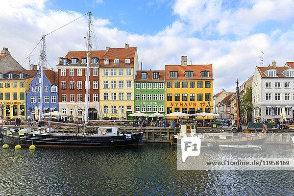 Colourful facades along canal and entertainment district of Nyhavn  Copenhagen  Denmark  Europe