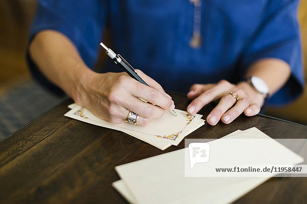 Close-up of woman writing letter