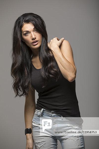 Portrait of brunette woman wearing black tank top