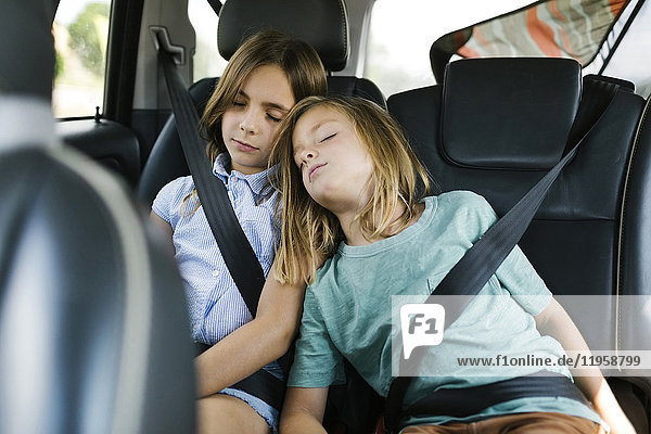 Brother (6-7) and sister ( 8-9) sleeping in car