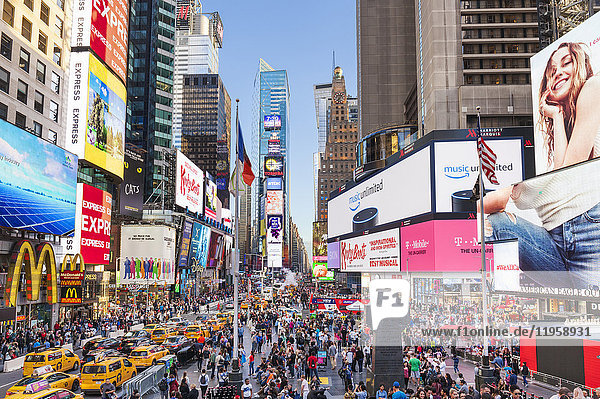 Crowds with busy traffic  yellow cabs  Times Square and Broadway  Theatre District  Manhattan  New York City  United States of America  North America