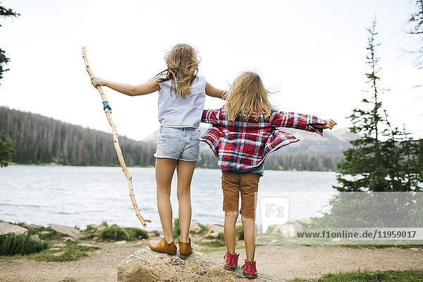 USA  Utah  Midway  Brother (6-7) and sister ( 8-9) standing by lake in forest