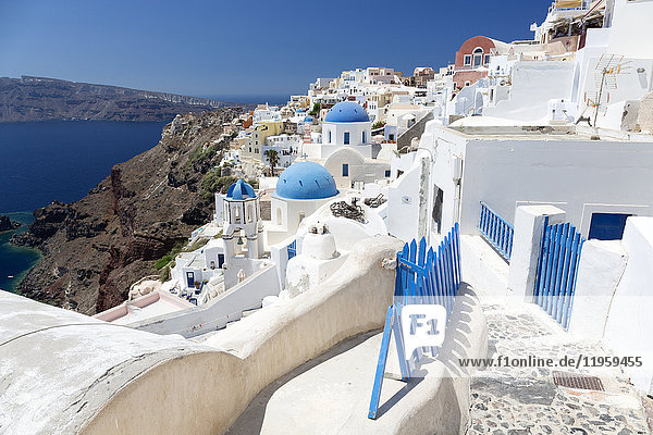 Classic view of the village of Oia with its blue domed churches and colourful houses  Oia  Santorini  Cyclades  Greek Islands  Greece  Europe