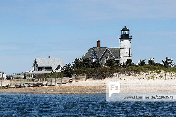 Sandy Neck Colony cottages and Sandy Neck Lighthouse  Cape Cod  Massachusetts  United States  North America.