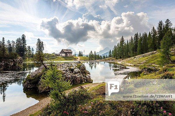 The peaceful Federa Lake with the cozy Croda da Lago refuge Cortina d'Ampezzo Belluno district Veneto Italy.